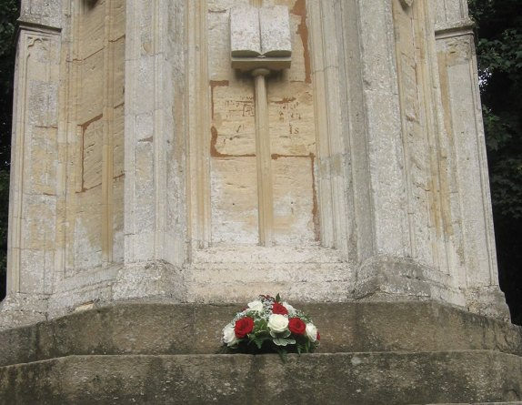 Flowers laid at Queen Eleanor's Cross in memory of the fallen