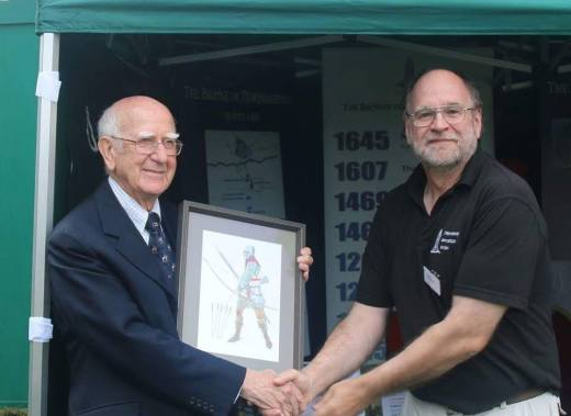 Vice chair Phil Steele accepts the award for outstanding battlefield society on NBS behalf from Sir Robert Worcester